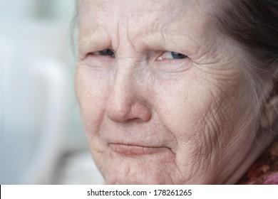 tough looking old woman, close up portrait