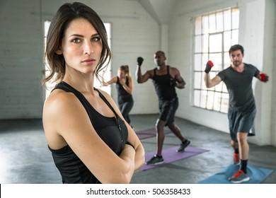 Tough serious confident stare champion athlete exercise trainer conviction focused powerful female