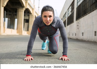 Tough woman exercising by pushup crossfit outdoor city urban fitness