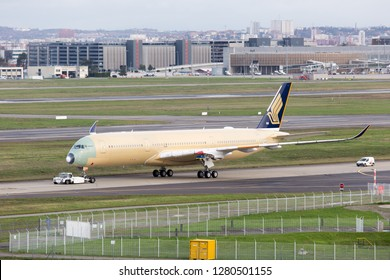Toulouse / France - 12.17.2018. Airbus Plant, Blagnac Airport. Modern passenger aircraft Airbus A350 XWB of Singapore Airlines towed along the airport runway.