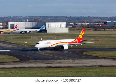 Toulouse / France - 12.17.2018. Airbus Plant, Blagnac Airport. Modern passenger aircraft Airbus A350 XWB of Hong Kong Airlines (HongKong Airlines) taxis on the airport runway.