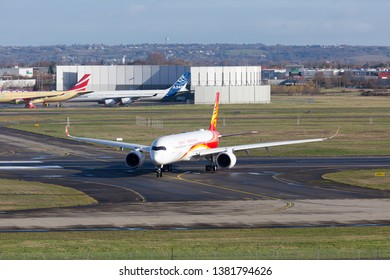 Toulouse / France - 12.17.2018. Airbus Plant, Blagnac Airport. Modern passenger aircraft Airbus A350 XWB of Hong Kong Airlines (HongKong Airlines) taxis on the airport runway. Front view of aircraft.