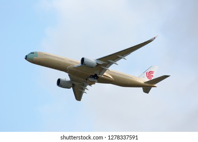 Toulouse / France - 12.17.2018. Blagnac Airport, Airbus Plant. Modern passenger aircraft Airbus A350 XWB of Air China Airlines is climbing in the blue sky.