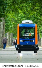 TOULOUSE ,FRANCE- 14 Jun 2018: The inhabitants of the city of Toulouse, walk next to a mini electric bus autonomous, on the esplanade Alain Savay. This transport is free.