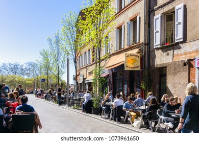 TOULOUSE, FRANCE - 26, MARCH, 2017 : Unknown group of people are having their lunch in a cafe in the city center on March 26, 2017 in Toulouse