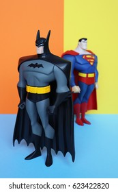 "TOULOUSE, FRANCE - April 18, 2017: Vintage 2003 BATMAN and SUPERMAN 10"" figures from the animated series Justice League by DC Comics and Mattel, on colorful background - Studio shot."