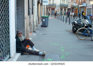 TOULOUSE, FRANCE - AUGUST 13, 2017: Homeless man begging on the street of Toulouse. Toulouse is the third largest city in France