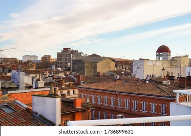 Toulouse, France - Jan. 2020 - Elevated views from a balcony in Victor Hugo Square on old brick or concrete town buildings in the historic neighborhood of Arnaud Bernard, in Toulouse city centre
