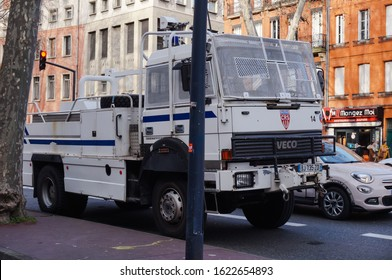 Toulouse, France - Jan. 2020 - An old Iveco riot truck of French National Police CRS units, equipped with a water gun, nudge bar, hoist and protection grids, during protests against the pension reform