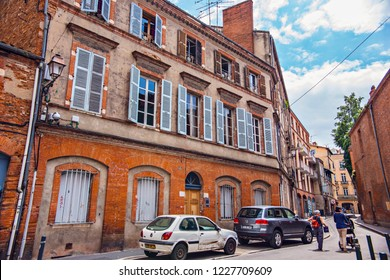 TOULOUSE, FRANCE - July 2018: Toulouse cityscape, people on the street, old houses of old town of Toulouse La Ville Rose, France
