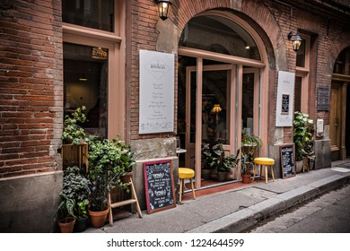 TOULOUSE, FRANCE - July 2018: Cozy restaurant in Toulouse downtown, France
