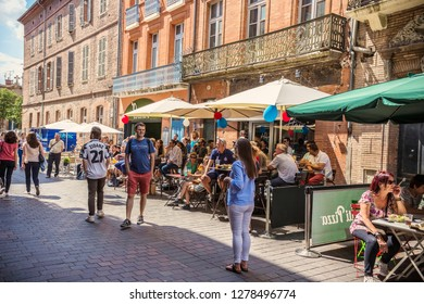 TOULOUSE, FRANCE - July 2018: Cozy outdoor restaurant in Toulouse downtown, France