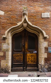 Toulouse, France - July 2018: Old wooden door in historical town of Toulouse The Ville Rose, France