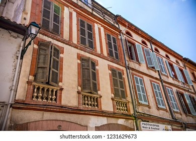 TOULOUSE, FRANCE - July 2018: Old houses and French balconies of Old town in Toulouse, Toulouse pink city (La Ville Rose), France