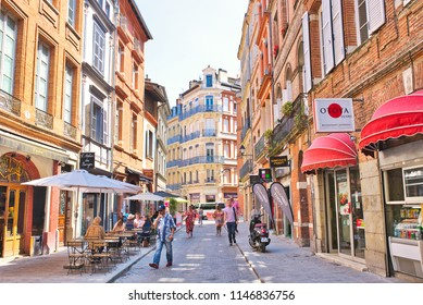 TOULOUSE, FRANCE - JULY, 2018: People walking in a heart of Toulouse - the Pink city 'Ville Rose'