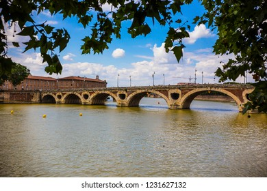 """TOULOUSE, FRANCE - July 2018: The Pont Neuf, French for """"New Bridge"""", is a 16th-century bridge in Toulouse, in the South of France"""