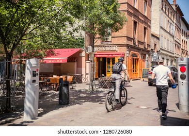 Toulouse, France - July 2018: Sunny day in Toulouse old town, people on the street, La Ville Rose town, Toulouse, France