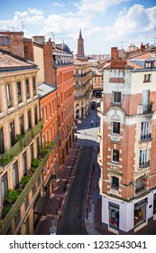 TOULOUSE, FRANCE - July 2018: Tiled roofs of Old town in Toulouse, Toulouse pink city (La Ville Rose), France