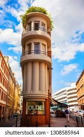 TOULOUSE, FRANCE - June 2018: Narrow building on Rue du Rempart Villeneuve in Toulouse center, French department of Haute-Garonne, region of Occitanie, La Ville Rose, Toulouse, France