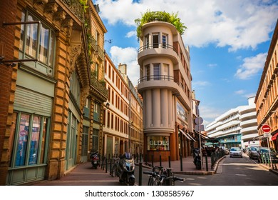 TOULOUSE, FRANCE - June 2018: Narrow building on Rue du Rempart Villeneuve in Toulouse center, French department of Haute-Garonne, region of Occitanie, La Ville Rose, Toulouse, France