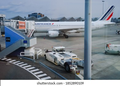 Toulouse, France - Oct. 2020 - A French-made Airbus A320 plane operated by Air France, during passengers' boarding at a terminal of Toulouse-Blagnac Airport, and a TDL pushback tractor on the tarmac