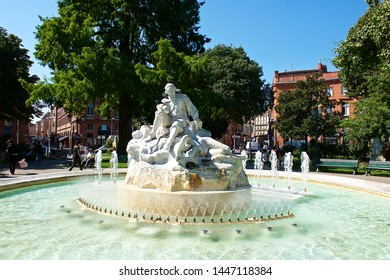 Toulouse, France-08 19 2015:The fountain in Wilson Square shows the poet P.Godolin, in the city of Toulouse, France.Toulouse is the capital of the department of Haute-Garonne.