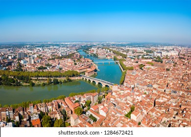 Toulouse and Garonne river aerial panoramic view. Toulouse is the capital of Haute Garonne department and Occitanie region in France.