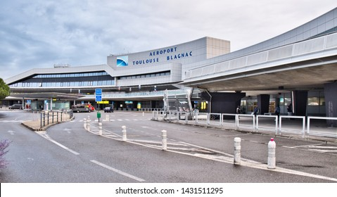 Toulouse Haute-Garonne France 06/21/19 Toulouse–Blagnac, sixth-busiest international airport in France. Main entrance, taxi drop off and parking.  Curved design concrete  building. Large Blue sign.