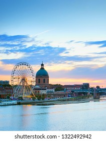 Toulouse landmarks on the bank of river Garone at sunset. France