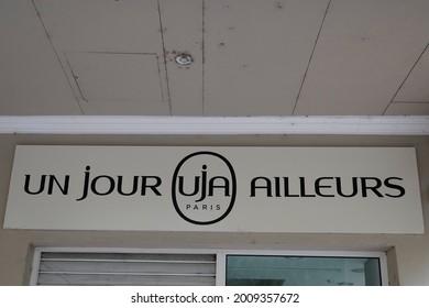 toulouse , occitanie France  - 06 25 2021 : un jour ailleurs uja shop retail logo brand girls women clothing fashion storefront sign text