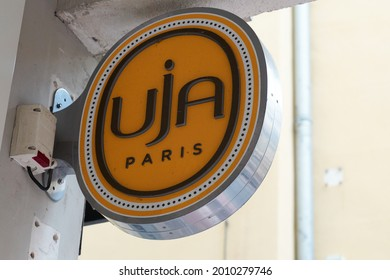 toulouse , occitanie France  - 06 25 2021 : uja paris brand un jour ailleurs logo and text sign of clothing fashion store women girls