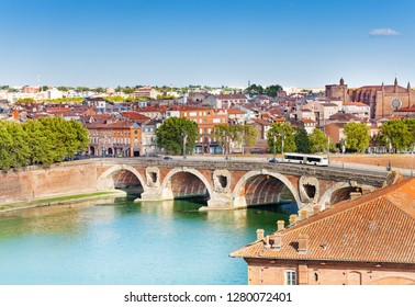 Toulouse and Pont Neuf bridge across Garonne river