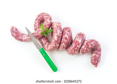 Toulouse sausage Raw twisted saucisse de toulouse - french meat specialty from Toulouse.