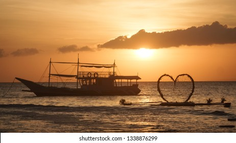 Tour Boat and Floating Heart - Love Theme at Sunset Beach Wedding - Boracay Island, Philippines