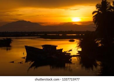 Tour Boat and Orange Sunset Sea Landscape - Hoi An, Vietnam