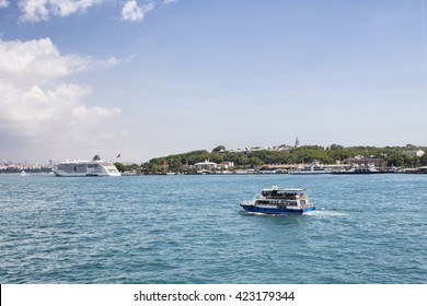 Tour boat passes in front of Topkapi palace in Istanbul