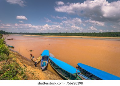 Tour boats at the coast of the Amazon rainforest in Manu National Park, Peru
