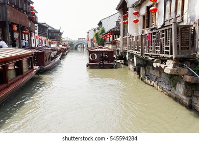 Tour boats moored on the Grand Canal in Suzhou