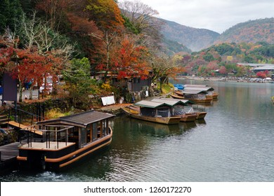 The tour boats park at Katsura river port in the late autumn of Arashiyama Park, Kyoto prefecture, Japan