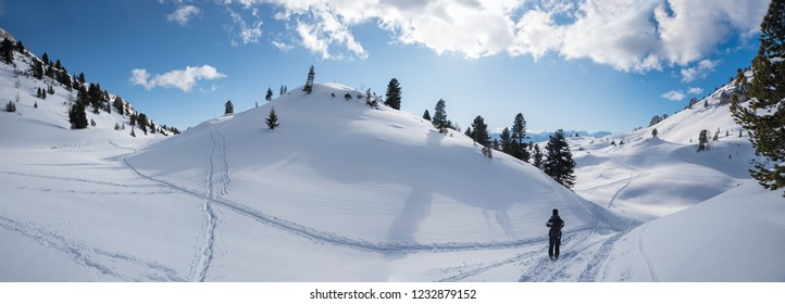 tour in breathtaking winter landscape. man walking at the mountain trail in the rofan area tirol austria