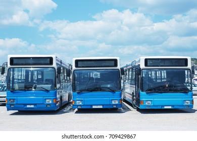 Tour buses await passengers. A Sunny summer day. Greece.