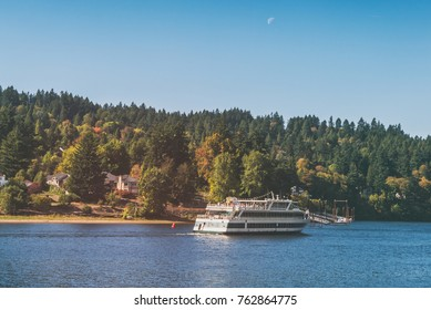A tour cruise an the Willamette River in Milwaukie, Oregon with the moon above.