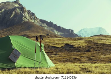 Tour du Mont Blanc.The tent is in the meadow.The solar panel hangs on the tent.