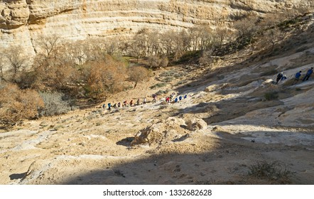 a tour group begins the hike out of the wadi zin canyon at ein avdat park in israel