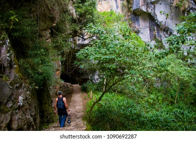 A tour guide enters the famous Sumaguing Cave in Sagada, Moutnain Province, Philippines