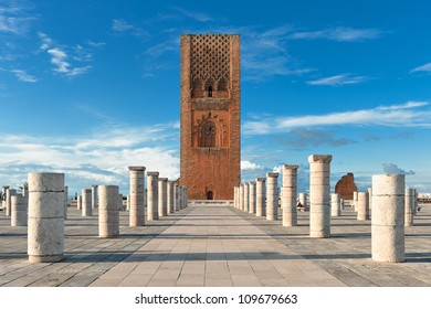 Tour Hassan tower in the square with stone columns. Made of red sandstone, important historical and tourist complex in Rabat, Morocco. Instead of stairs, the tower is ascended by ramps.