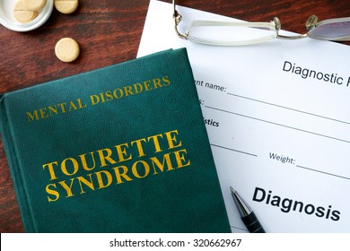 Tourette syndrome concept. Diagnostic form and book on a table.
