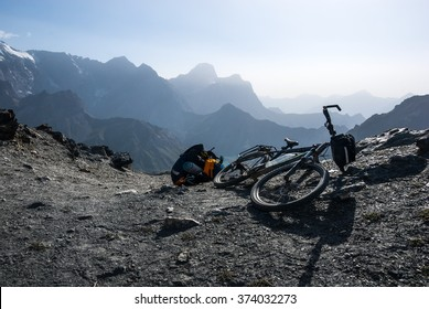 Touring bicycle and pannier on the mountain pass trail