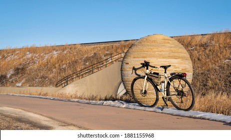 touring bicycle parked on kickstand, fall or winter scenery in Fort Collins, Colorado, recreation and commuting using bike trails