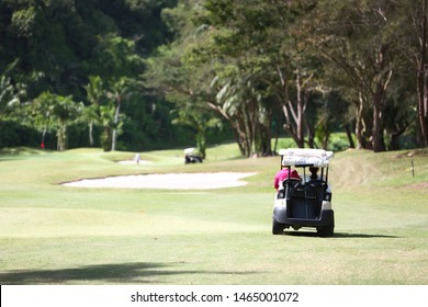 Touring a golf course on a buggy.